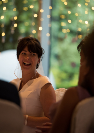Bride laughing at wedding